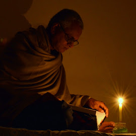 Reading in Candle light by Kaushik Mondal - Novices Only Portraits & People ( candle, reading, dark, book, light )