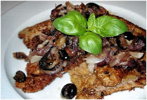 Breaded veal filets with onions and black olives
