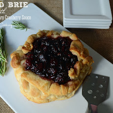 Baked Brie with Balsamic Rosemary Cranberry Sauce