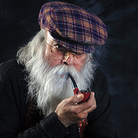 Man smoking pipe by Rakesh Syal - People Portraits of Men