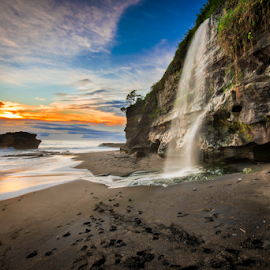 sunset at tanah lot by Anton Subiyanto - Landscapes Beaches ( beaches, dawn, sunset, waterfall, long exposure, sunrise, cave, rocks, dusk, slow shutter )