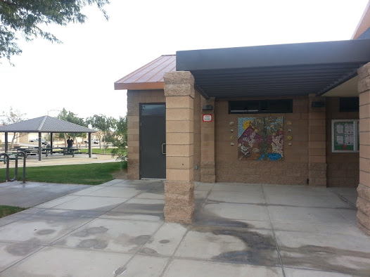 The wall-mounted mural is located at the entrance to the Art Samson Community Library in Thousand Palms, California.