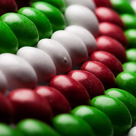 Candy Coated Chocolate. by Ken Brown - Food & Drink Candy & Dessert ( curve, colorful, colors, green, christmas, white, yummy, fun, landscape, rows, lined-up, m&ms, holiday, flickr, chocolate, tempting, tasty, sweet, red, candy, happy, food, facebook, celebration,  )