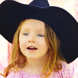 Cowgirl Surprise by Cheryl Korotky - Babies & Children Child Portraits ( western wear, a heartbeat in time photography, amazing faces, beautiful children, cowgirl, child model nevaeh, portrait, western hat )