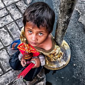 Small Kid Seller by Ferdinand Ludo - Babies & Children Child Portraits ( holding sto nino, candle seller, sidewalk,  )