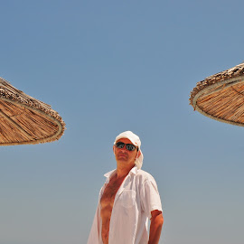 Sunny day by Zoran Dejanović - People Portraits of Men ( mature man, sunshade, beach, man, sunbathing )