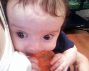 Kaden sucking on his teething toy