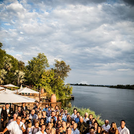 Reception by the Zambezi by Werner Booysen - Wedding Groups ( wedding photos destination, reception, wedding photography, weddings, wedding day, wedding, zambia, marriage, group, people, river, werner booysen,  )