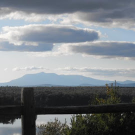took this picture of Mt Katahdin from the 95 scenic overlook it was an amazing trip I'd love to do it again sameday. by Deborah Arsenault - Landscapes Mountains & Hills