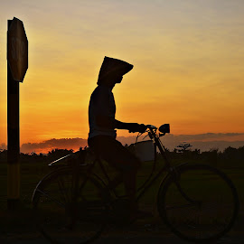 old man on bicycles by Yudi Dhaniwanto - Transportation Bicycles ( bicycles )