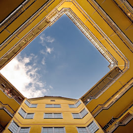 Leveles of an yellow  building by Péter Mocsonoky - Buildings & Architecture Architectural Detail ( home, nobody, old, yard, residential, exterior, inner, court, apartment, yellow, architecture, house, surround, city, open, level, sky, levels, perspective, internal, construction, hole, building, structure, corner, flat, patio, angle, urban, residence, window, blue, cloud, square, view, town, courtyard, wall, design, quarter )