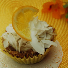 Lemon Pudding Filled Coconut Cupcakes with Shaved Coconut Topping