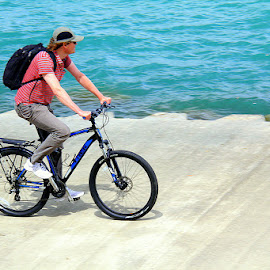 Cycling along Lake Michigan by Leong Jeam Wong - Transportation Bicycles ( water, cyclist, michigan, cycle, backpack, lake, bicycle )