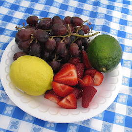 Camping Appetizers by Kaye Petersen - Food & Drink Fruits & Vegetables ( fruit, tablecloth, camping, grapes, food, lime, strawberry, lemon,  )