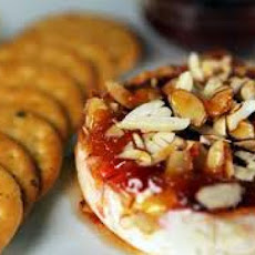 Baked Brie Stuffed With Strawberry Preserves and Toasted Almonds