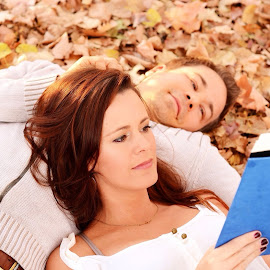 Relaxing with a book by Rj Smith - People Couples ( reading, fall, book, couple, brunette )