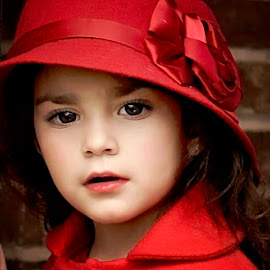 Girl in red hat by Darya Morreale - Babies & Children Child Portraits ( red, girl, brick, wall, hat )