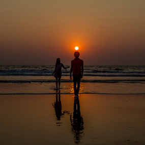 Sunset by Debajit Bose - Landscapes Sunsets & Sunrises ( landspace, couple in sunset, nature, goa, sea, couple )