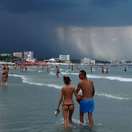 Into the storm by Nicu Buculei - News & Events Weather & Storms ( waves, couple, beach, storm, rain )