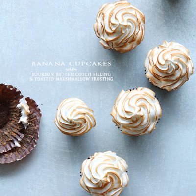 Banana Cupcakes with Bourbon Butterscotch Filling and Toasted Marshmallow Frosting