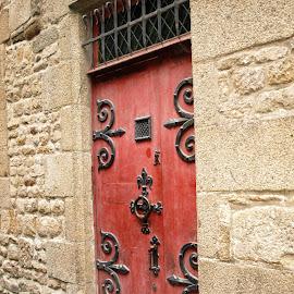 A bright door inside mystical Mont Saint Michel by Nickoleta Antonopoulos Nguyen - Buildings & Architecture Other Exteriors ( red door, castle door, door, mont saint michel,  )