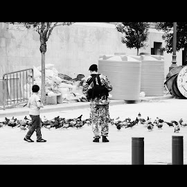 I still believe in love and peace... by Simona David - City,  Street & Park  Street Scenes ( army, guns, peaceful, symbol of peace, doves, beirut, wars, birds, street photography,  )