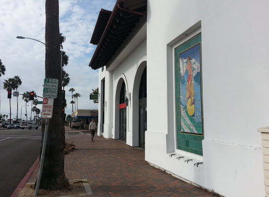 """Surfer"" is one of several murals installed in San Clemente's downtown district.  The site for this mural also allowed for ceramic starfish medallions at the base of the niche."