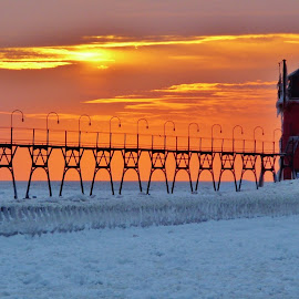 A Frozen Beacon of Light  by Terry Butcher - Buildings & Architecture Public & Historical ( michigan, winter, lake michigan, ice, sunset, lighthouse, frozen lake, pier, frozen, south haven, frosty,  )