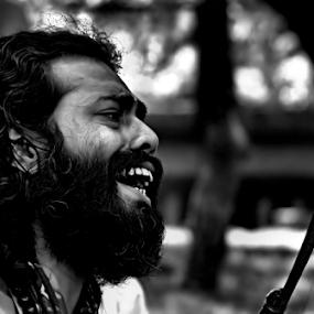 Humming the tune by Biraj Dutta - People Portraits of Men ( bowl, singing, man singing,  )
