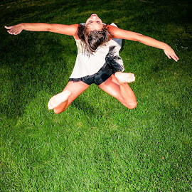 Dance or Sky Dive? by Scott Zinda - People Musicians & Entertainers ( flash, girl, grass, ballet, dance, leap, jump )