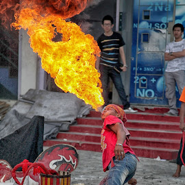 Fire Breathing Man by Linnawati Selamet - News & Events Entertainment