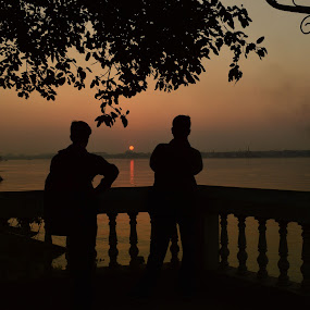 end of another day by Jayanti Chowdhury - Landscapes Sunsets & Sunrises ( sunset, silhouettes, riverscape )