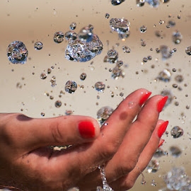 Freezed water drops by Artur Beilin - Nature Up Close Water ( hand, water, waterdrop, fountain, catch )