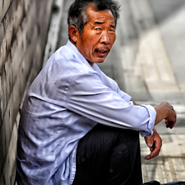 Uncle In Beijing by Ferdinand Ludo - People Portraits of Men ( tourist, elderly in beijing, waiting for the bus, china,  )