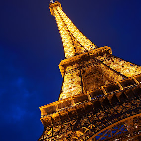 Eiffel Tower Twilight by Nicolas Raymond - Buildings & Architecture Public & Historical ( vertical, travel, yellow, architecture, french, glow, long, capital, attraction, historic, city, lamps, sky, iconic, wonder, diagonal, black, orange, tilted, structure, twilight, white, tourism, somadjinn, landmark, european, touristic, exposure, famous, europe, eiffel, beauty, pretty, iron, paris, nicolas raymond, france, monument, evening, lit, icon, building, editorial, tilt, beautiful, urban, tower, blue, parisian, night, historical, glowing, , colorful, mood factory, vibrant, happiness, January, moods, emotions, inspiration )