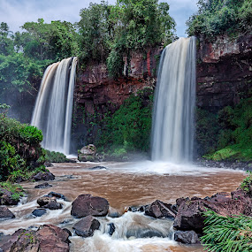 The Brothers by Jay Gould - Landscapes Waterscapes ( the brothers, blue sky, waterfalls, iguazu falls, white clouds, long exposure )