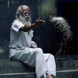 The sadhu by Yogesh Waikul - People Street & Candids ( monochrome, street, feeding, white, candid, black )