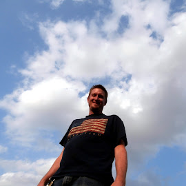 Baby's eye view by Jen Rhora - People Portraits of Men ( clouds, flag, sunny, summer, man )
