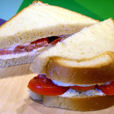 2- Handed Kitchen Sink Tomato Sandwich