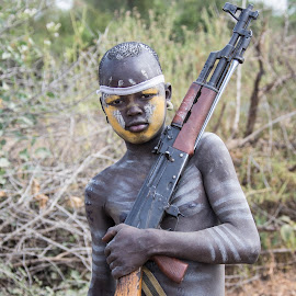 Boy with gun by Mike O'Connor - People Street & Candids ( guns, jinka to omo river, omo river valley, mursi tribe, ethiopia )