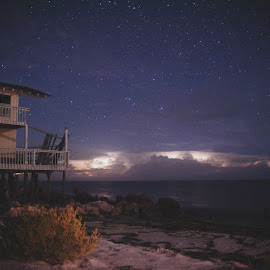 Violent Sky by John Smith - Landscapes Beaches ( thunder, clouds, sand, beach house, forgotten coast, collaboration, erosion, speedbooster, waves, metabones, beach, e-m1, lightning, light painting, florida, stars, long exposure, astrophotography, night, o-md, rocks, olympus )