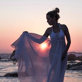 Sunset girl by Peter Wilkins - People Portraits of Women ( girl, sunset, sea, white dress, rocks )