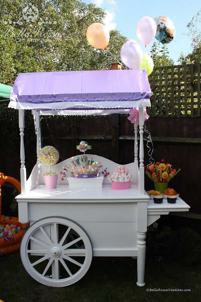 Waybuloo themed cart with sherbet saucer sweet tree, lollipop arrangement, marshmallow cake & fruit bouquet