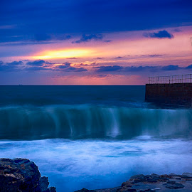 Porthleven Pier by John Richards - Landscapes Sunsets & Sunrises ( porthleven, wave, sea, pier, sun )