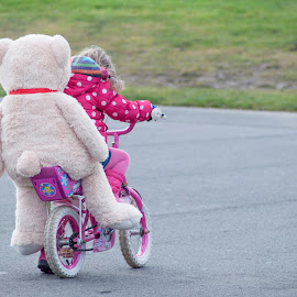 Big teddy rides his bike by Ruth Holt - Novices Only Street & Candid ( ride, cycle, bike, park, play, childlike, bicycle, teddy )