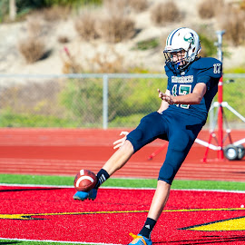 Punishing the ball... by Kevin Mummau - Sports & Fitness American and Canadian football ( punting, ball, kick, football, punt, blue shoes )
