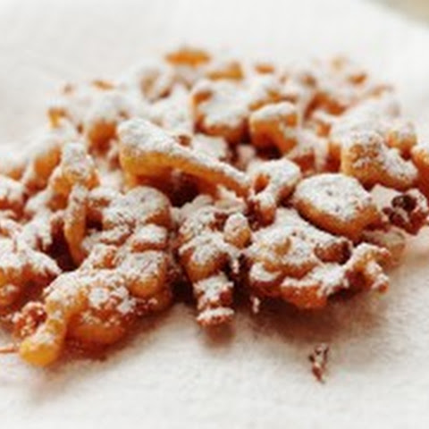 Orange Funnel Cake with Powdered Cinnamon Sugar and Maple Syrup