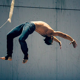 Flying acrobat by Zsolt Rozsavolgyi - People Musicians & Entertainers ( flying, acrobat, action, aerial, man,  )