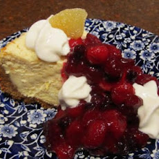 Festive Creamy Cheesecake With Tangy Cranberry Topping!