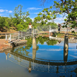 Reflecting Bridge by Kathy Suttles - City,  Street & Park  City Parks ( footbridge, oklahoma blue, reflecting )
